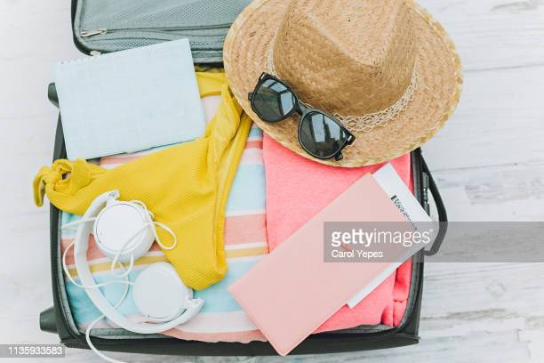 items for a summer traveler - packing stock pictures, royalty-free photos & images