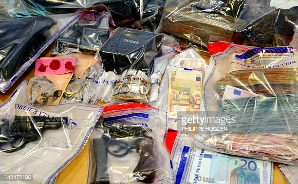 Items including weapons and euro notes are presented to the press on April 20 in Lille following a police investigation A network of drug traffickers...