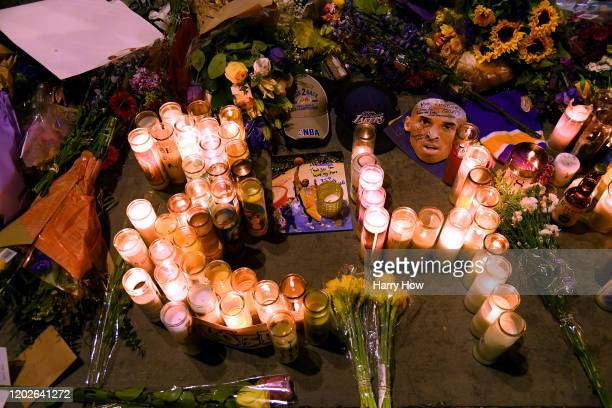 Items left by fans to pay their respects to Kobe Bryant at LA Live on January 28 2020 in Los Angeles California