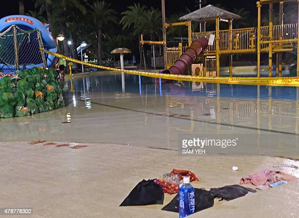 Items lie on the ground on the explosion site which was sealed off by police at the Formosa Fun Coast amusement park after an explosion in the Pali...