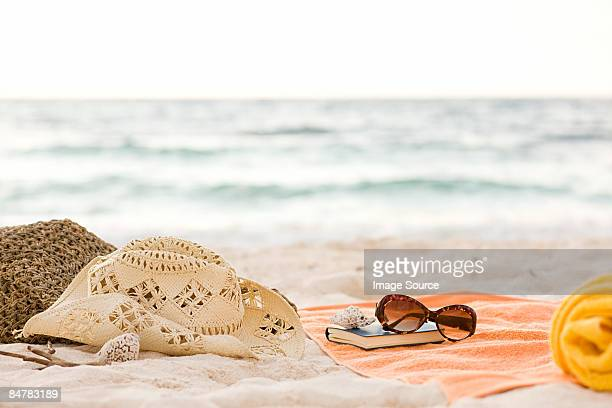 items on a beach - towel stock pictures, royalty-free photos & images