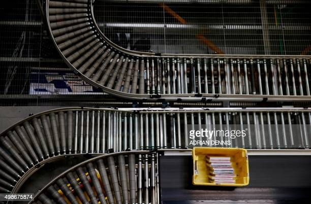 Items travel in a yellow crate as it moves along an automated conveyor belt inside an Amazoncouk fulfillment centre in Hemel Hempstead north of...