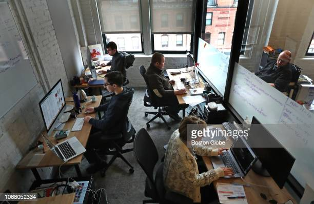 Iterators company president Jill Willcox, bottom right, and her son, Oliver, top left, work in the small WeWork office of Iterators, a software...