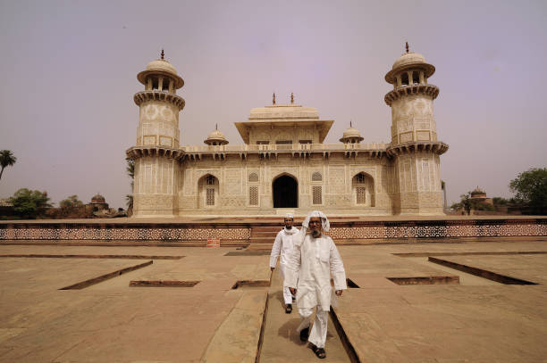 Itimad-ud-Daulah (called baby Taj), seen with current custodians , in Agra, India.