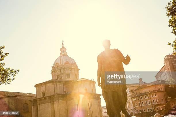 itlay, rome, statue of julius caesar at back light - julius caesar stock photos and pictures