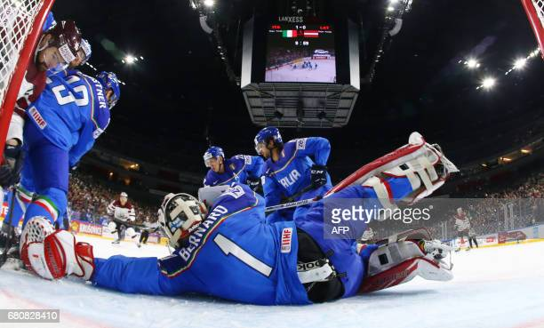 Itly´s goalkeeper Andreas Bernard vies for the puck during the IIHF Ice Hockey World Championships first round match between Italy and Latvia in...