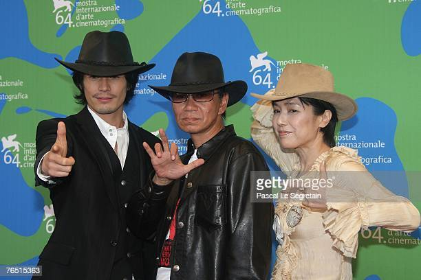 Ito Hideaki Miike Takashi and Momoi Kaori attend the Sukiyaki Westerm Django photocall in Venice during day 8 of the 64th Venice Film Festival on...
