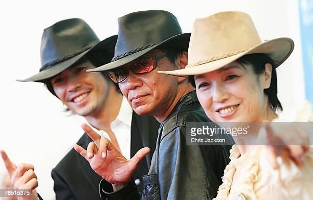 Ito Hideaki Miike Takashi and Momoi Kaori attend the Sukiyaki Westerm Django photocall in Venice during day 8 of the 64th Venice Film Festival on...
