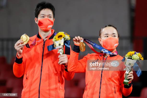 Ito Mima and Jun Mizutani and Ito Mima of Team Japan pose with their medals after winning their Mixed Doubles Gold Medal match on day three of the...
