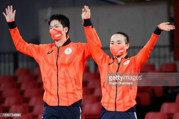 Ito Mima and Jun Mizutani and Ito Mima of Team Japan wave during the medal ceremony for the Mixed Doubles table tennis on day three of the Tokyo 2020...