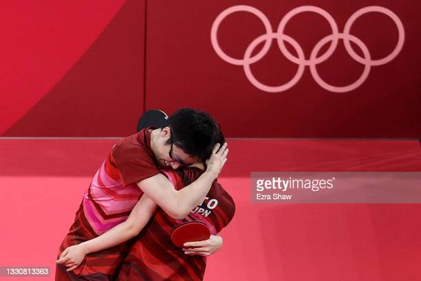 Ito Mima and Jun Mizutani of Team Japan celebrate winning during their Mixed Doubles Gold Medal match on day three of the Tokyo 2020 Olympic Games at...