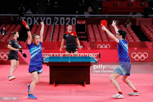 Ito Mima and Jun Mizutani of Team Japan celebrate winning their Mixed Doubles Quarterfinal match on day two of the Tokyo 2020 Olympic Games at Tokyo...