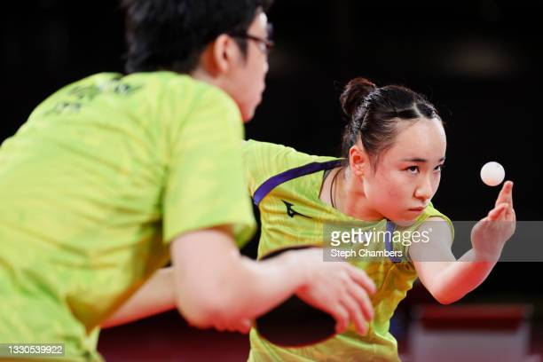 Ito Mima and Jun Mizutani of Team Japan in action during their Mixed Doubles Semifinal match on day two of the Tokyo 2020 Olympic Games at Tokyo...