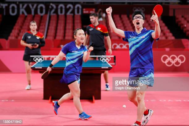 Ito Mima and Jun Mizutani of Team Japan react during their Mixed Doubles Quarterfinal match on day two of the Tokyo 2020 Olympic Games at Tokyo...