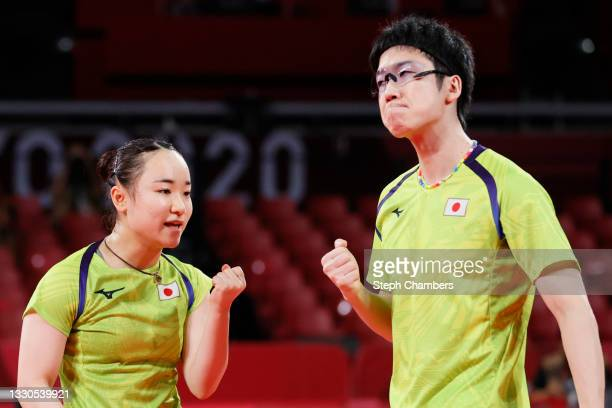 Ito Mima and Jun Mizutani of Team Japan react during their Mixed Doubles Semifinal match on day two of the Tokyo 2020 Olympic Games at Tokyo...