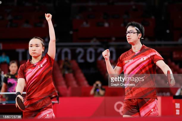 Ito Mima and Jun Mizutani of Team Japan react during their Mixed Doubles Gold Medal match on day three of the Tokyo 2020 Olympic Games at Tokyo...