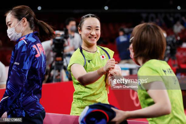 Ito Mima of Team Japan fistbumps her teammate Hirano Miu during their Women's Team Semifinal table tennis match on day eleven of the Tokyo 2020...