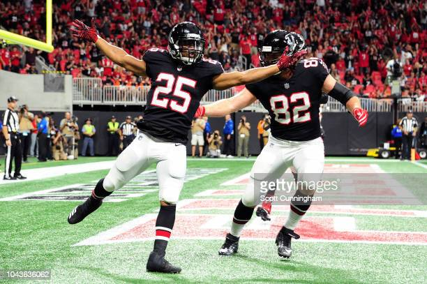 Ito Smith of the Atlanta Falcons celebrates a touchdown during the first quarter against the Cincinnati Bengals at MercedesBenz Stadium on September...