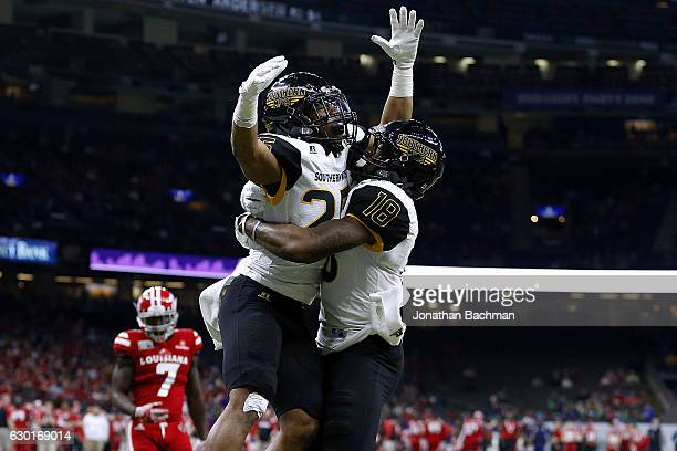 Ito Smith of the Southern Miss Golden Eagles celebrates a touchdown with Korey Robertson during the first half of a game against the...