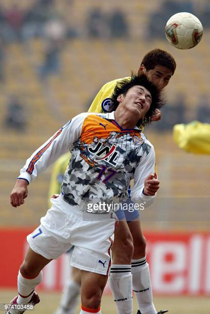 Ito Teruyoshi of Shimizu SPulse of Japan heads the ball with Yoon Jong Hwan of Seongnam of Korea during the AFC Champions League Group B match at...