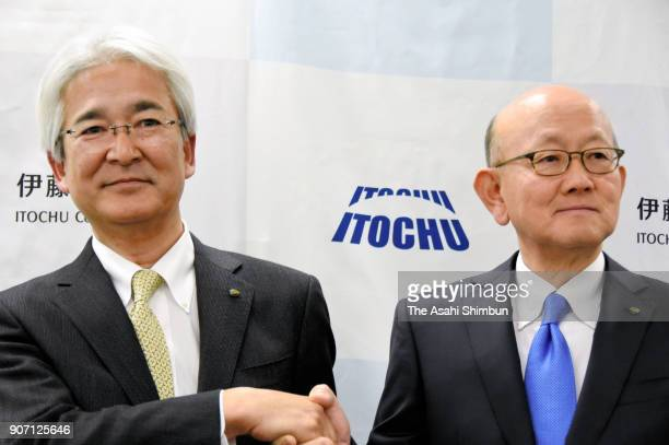Itochu Corp incoming president Yoshihisa Suzuki and outgoing president Masahiro Okafuji shake hands during a press conference on January 18 2018 in...