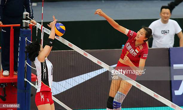 Itoh Nozomi of Japan defends as Yuan Xinyue of China sends the ball over the net during Women's Volleyball match between China and Japan on day four...