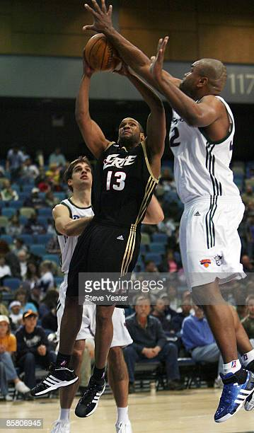 Itony Bethel of the Erie Bayhawks shoots against Alton Ford of the Reno Bighorns during a DLeague game at the Reno Events Center on April 4 2009 in...