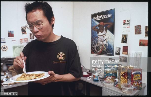 It's 6 am and Eric Ng eats frozen french toast in his office at Yahoo where he's what they call a technical yahoo Ng preferred to work at night and...