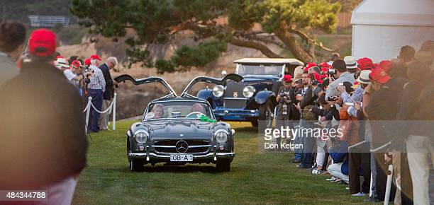 It's a 1955 MercedesBenz 300 Gullwing driven by Andries Meuzelaar along for the ride is he wife Hannie followed by a 1929 Du Pont Roadster Model...