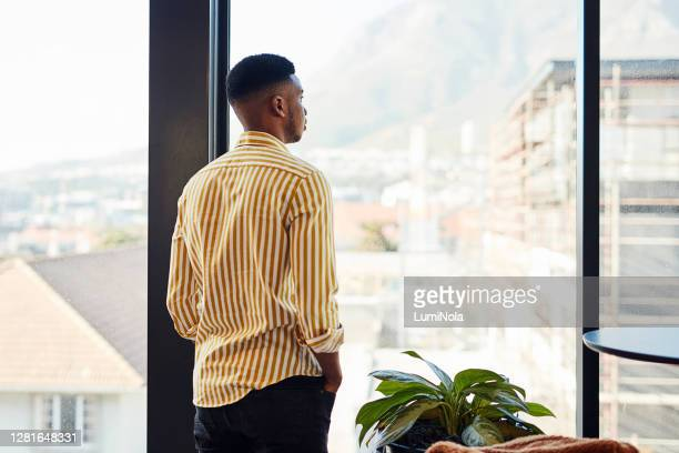 it's a big world filled with big potential - looking through window stock pictures, royalty-free photos & images