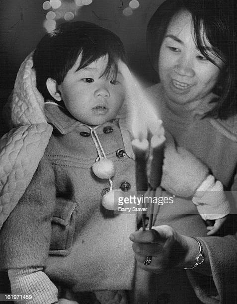 FEB 15 1972 FEB 16 1972 It's A Brand New Year For Chinese Mrs Jean Wong and her son Richard 14 months were among the crowd of about 200 persons who...