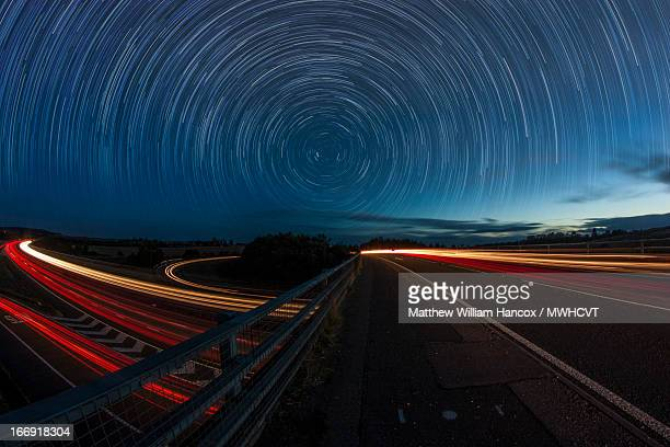 it's a curved world (explored) - star trail stock pictures, royalty-free photos & images