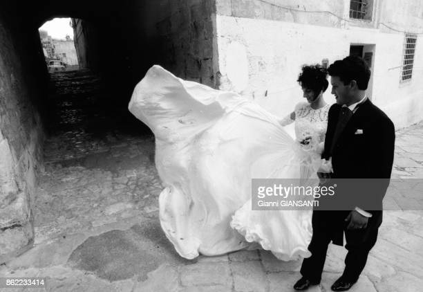 It's a local tradition to walk alone along the town's street immediatly after the wedding cermony Matera 19 October 1991 Italy