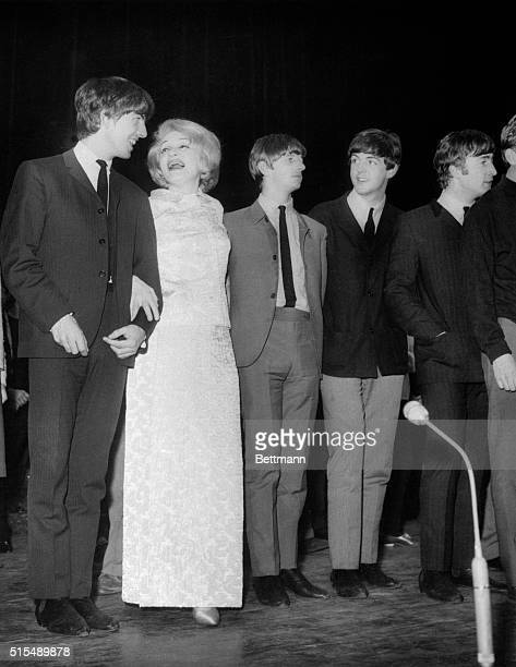 It's a mutual admiration society as Marlene Dietrich gets together with the Beatles during a rehearsal for a 1963 Royal Variety Show in London