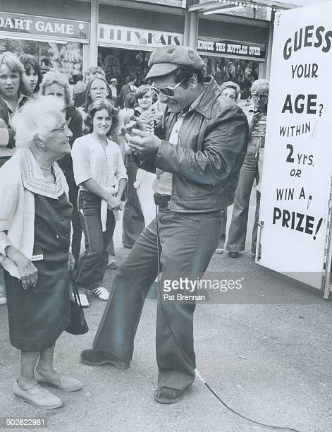 It's a nineyear miss for ageguesser Barry Vigon as 105yearold Caroline Pierce smiles mischievously at the CNE Midway yesterday She's been his oldest...