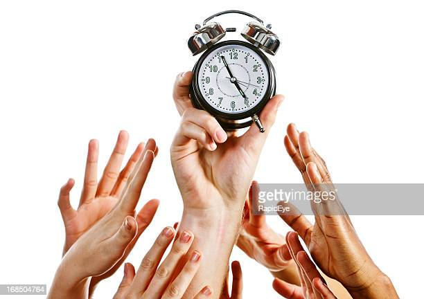 It's a race against time; many hands grab alarm clock