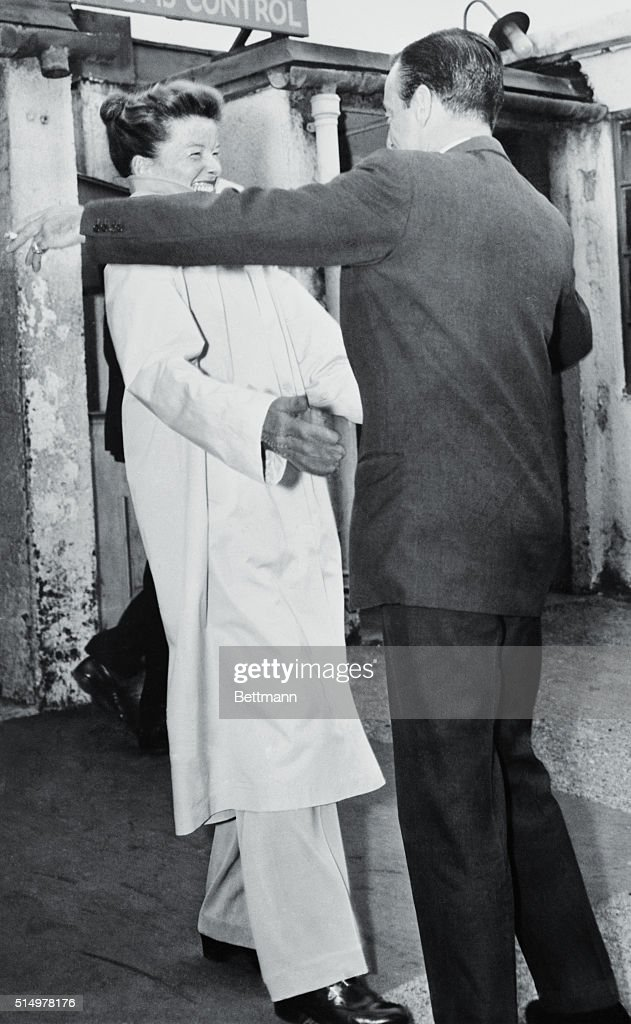 Portrait of katharine hepburn with robert helpmann pictures getty its a warm greeting at london airport may 25th despite the cold weather as m4hsunfo