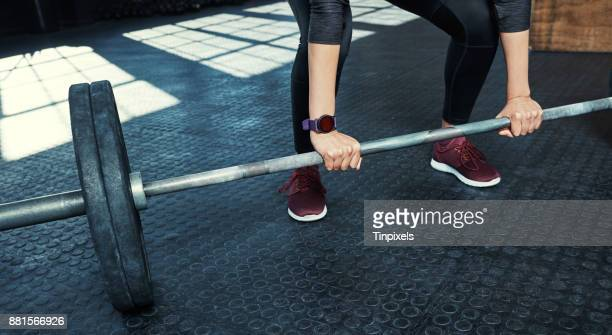 it's all about becoming stronger - women's weightlifting stock pictures, royalty-free photos & images