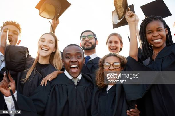 it's all cheers and smiles today - graduation cap stock pictures, royalty-free photos & images