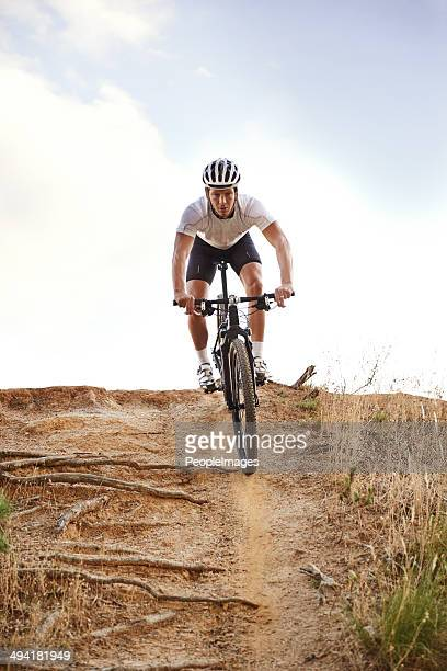 it's all downhill from here...on my bike! - bicycle trail outdoor sports stock photos and pictures