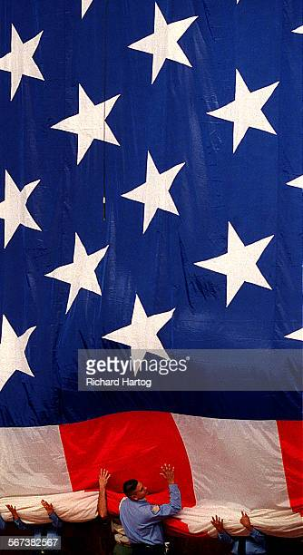 It's all hands on as color guards team up to gather up what is billed as the world's largest flying indoor American flag during a Memorial Day...