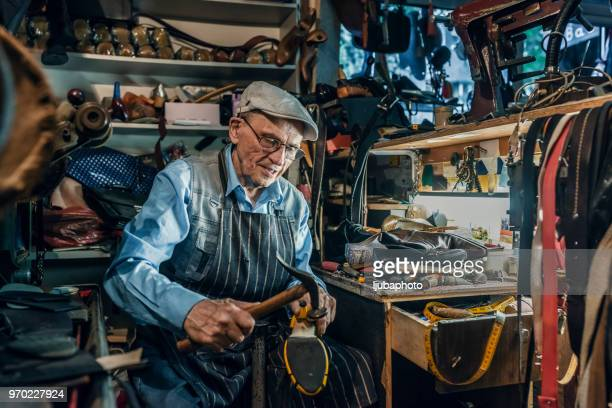 it's all in the details - shoemaker stock photos and pictures