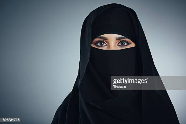 it's all in the eyes - burka stock photos and pictures