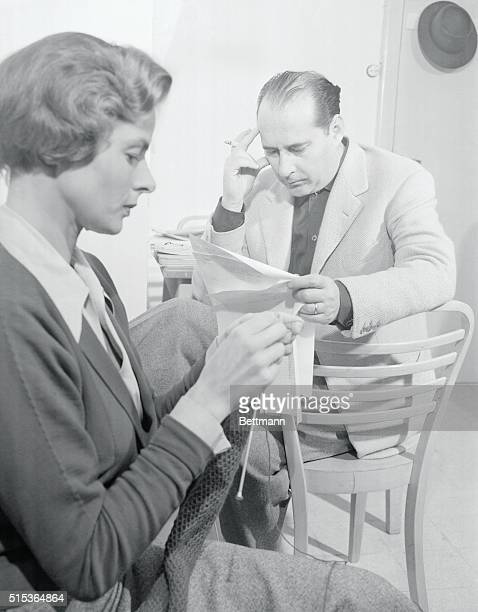 It's All in the Family Rome Italy Italian movie director Roberto Rossellini looks over the shooting schedule of his latest picture with his wife...