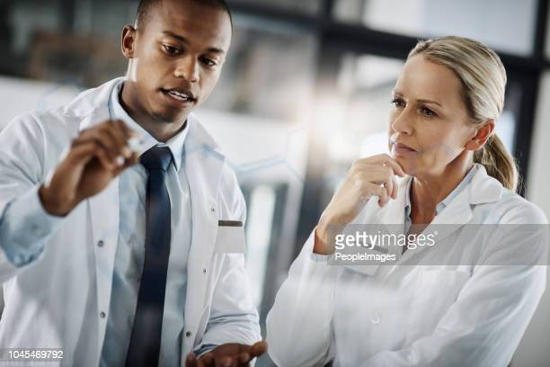 it's all in the formula - laboratory coat stock photos and pictures