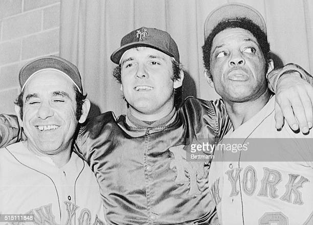 It's all smiles for New York Mets manager Yogi Berra pitcher Tug McGraw and Willie Mays after the Mets won the second game of the 1973 World Series...