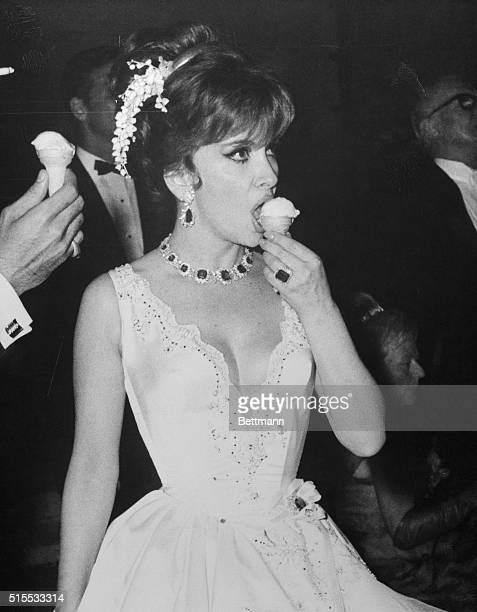 It's always a refreshing sight watching actress Gina Lollobrigida refreshing herself Here she munches littlegirl style on an ice cream cone at the...