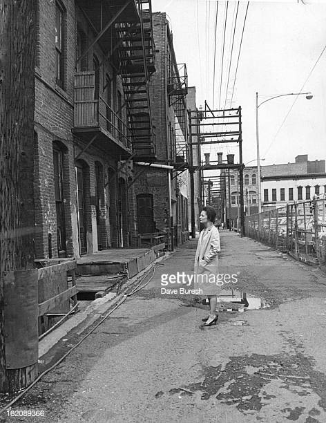 MAY 28 1965 MAY 31 1965 It's An Alley Now But Wait A Few Months Dana Crawford president of Larimer Square Inc looks at the back of Sussex Hotel...