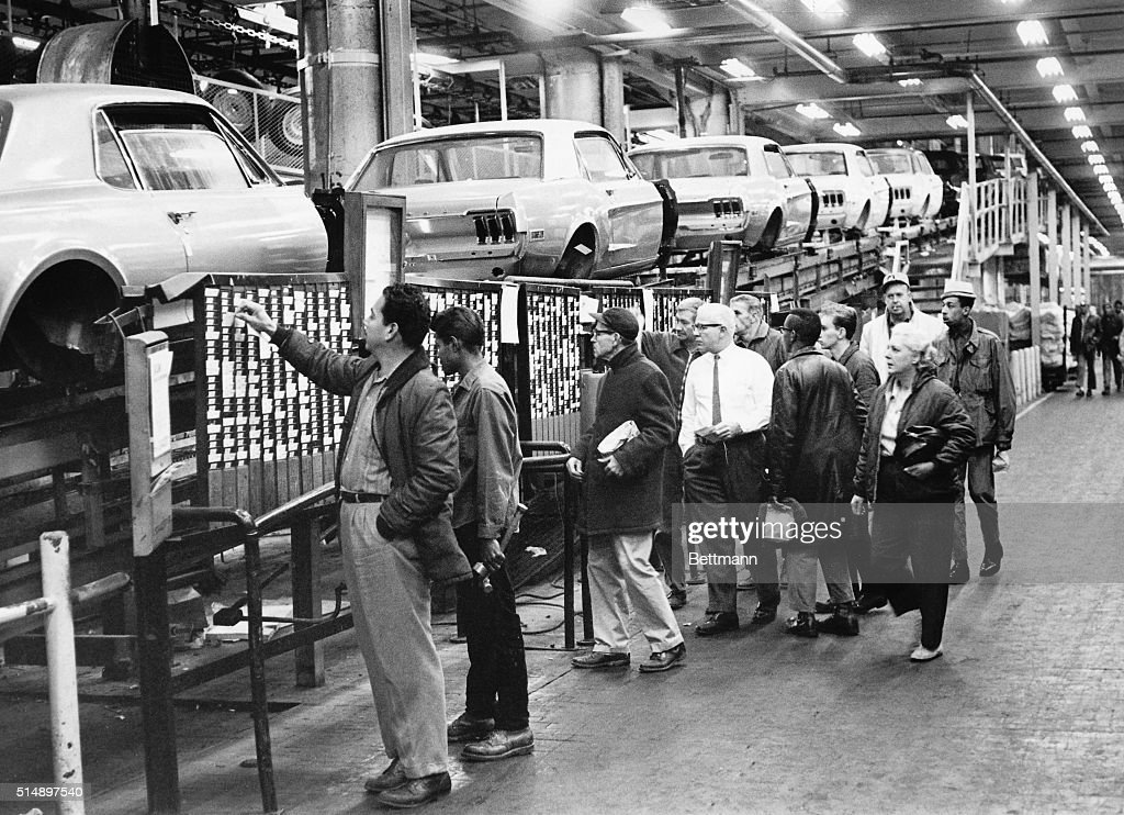 Ford Auto Workers Punching Time Clocks : News Photo