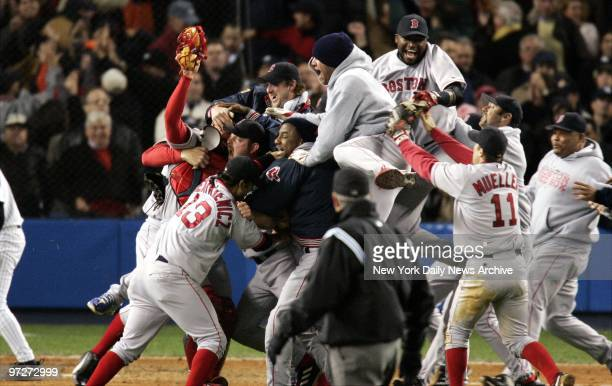 It's bedlam - but a happy kind - as Boston Red Sox players explode with joy after their 10-3 victory over the New York Yankees in Game 7 of the...